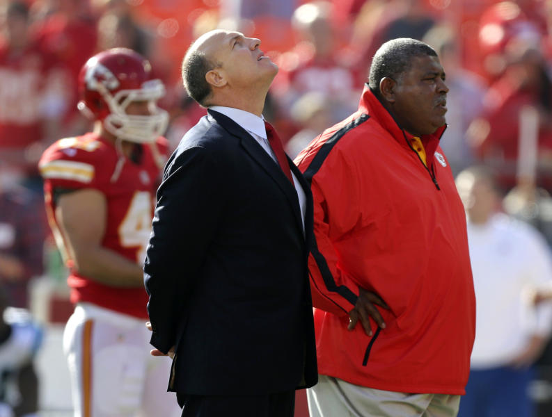 Kansas City Chiefs general manager Scott Pioli, left, and coach Romeo Crennel stand together before an NFL football game against the Carolina Panthers at Arrowhead Stadium in Kansas City, Mo., Sunday, Dec. 2, 2012. On Saturday, Kansas City Chiefs linebacker Jovan Belcher thanked Pioli and Crennel for giving him a chance in the NFL, before he turned away and fatally shot himself. (AP Photo/Ed Zurga)
