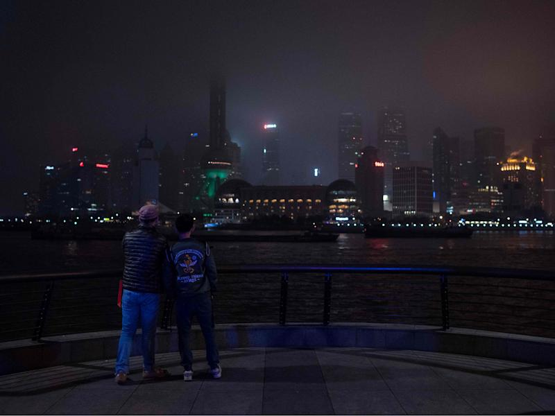 The Shanghai skyline descends into darkness during Earth Hour last year: AFP