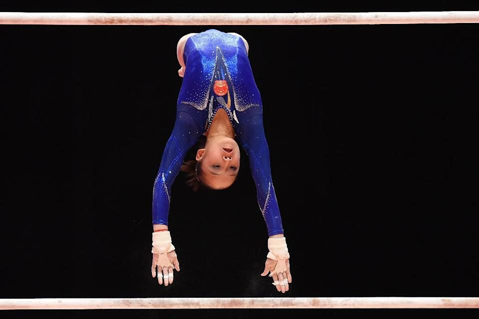 China's Fan Yilin competes during the Women's Uneven Bars Final at the 2015 World Gymnastics Championship in Glasgow, Scotland, on October 31, 2015 (AFP Photo/Ben Stansall)
