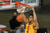 Iowa State forward George Conditt IV dunks the ball during the first half of an NCAA college basketball game against Oklahoma, Saturday, Feb. 20, 2021, in Ames, Iowa. (AP Photo/Charlie Neibergall)