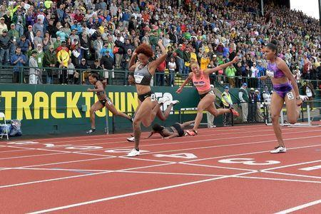 Jul 8, 2016; Eugene, OR, USA; Nia Ali (left) and Queen Harrison (second from left) and Brianna Rollins (middle) and Kristi Castlin (right) compete during the women's 100m hurdles finals in the 2016 U.S. Olympic track and field team trials at Hayward Field. Mandatory Credit: Kirby Lee-USA TODAY Sports