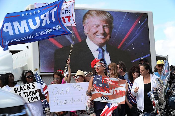 <p>People show their support for President Donald Trump near his Mar-a-Lago resort home in West Palm Beach, Fla., March 4, 2017. (Photo: Joe Raedle/Getty Images) </p>