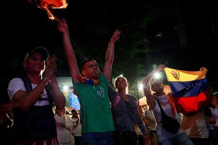 Opposition supporters react while waiting for results of the unofficial plebiscite against President Nicolas Maduro's government and his plan to rewrite the constitution, in Caracas, Venezuela July 16, 2017. REUTERS/Marco Bello