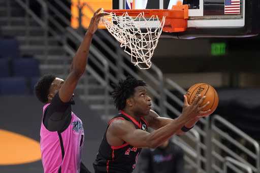 Toronto Raptors forward OG Anunoby (3) goes up for a shot behing Miami Heat center Bam Adebayo (13) during the second half of an NBA basketball game Wednesday, Jan. 20, 2021, in Tampa, Fla. (AP Photo/Chris O'Meara)