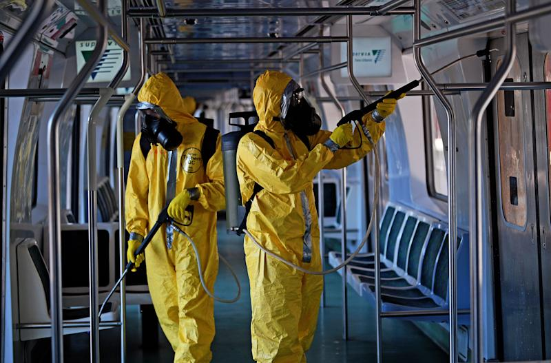 Brazilian soldiers disinfect a train carriage in Central Station as a measure against the spread of the coronavirus, COVID-19, pandemic in Rio de Janeiro on March 26, 2020. (Photo by CARL DE SOUZA / AFP) (Photo by CARL DE SOUZA/AFP via Getty Images)