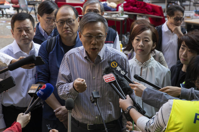 President of the Polytechnic University Jin-Guang Teng speaks to the media at the campus in Hong Kong on Wednesday, Nov. 20, 2019. A small group of protesters refused to leave the Polytechnic University, the remnants of hundreds who took over the campus for several days. They won't leave because they would face arrest. Police have set up a cordon around the area to prevent anyone from escaping. (AP Photo/Ng Han Guan)