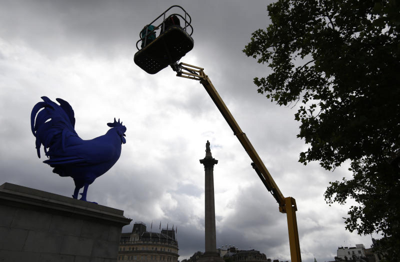 "A giant blue rooster is unveiled in central London's Trafalgar Square, Thursday, July 25, 2013. A giant blue rooster was unveiled Thursday next to the somber military monuments in London's Trafalgar Square. German artist Katharina Fritsch's 15-foot (4.7 meter) ultramarine bird, titled ""Hahn/Cock,"" is intended as a playful counterpoint to the statues of martial heroes in the square. It is the latest in a series of artworks to adorn the vacant ""Fourth Plinth"" in the square that is home to Nelson's Column. (AP Photo/Lefteris Pitarakis)"
