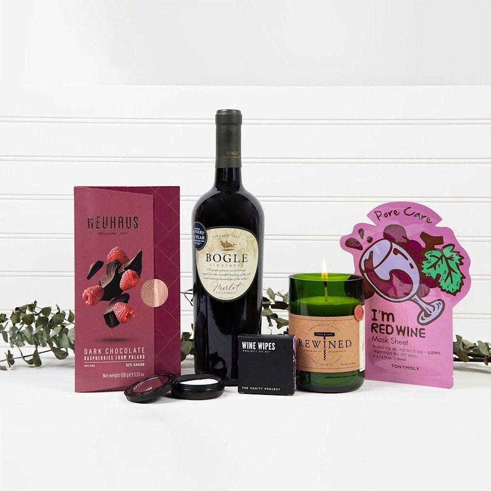 """<p><strong>GiftBasket.com</strong></p><p>giftbasket.com</p><p><strong>$119.99</strong></p><p><a href=""""https://go.redirectingat.com?id=74968X1596630&url=https%3A%2F%2Fgiftbasket.com%2Fproducts%2Fwine-down-spa-set%3Fvariant%3D31971828170850%26gclid%3DCj0KCQjwqKuKBhCxARIsACf4XuGxlkNXKl67_PQuI_WhZyah40E_4YAsweFot9dN8aA2O5adxJFEDKIaAq5uEALw_wcB&sref=https%3A%2F%2Fwww.cosmopolitan.com%2Flifestyle%2Fg37682336%2Fbest-wine-gift-baskets%2F"""" rel=""""nofollow noopener"""" target=""""_blank"""" data-ylk=""""slk:Shop Now"""" class=""""link rapid-noclick-resp"""">Shop Now</a></p><p>Nothing says """"I know you hate your job and they don't deserve you, but I love you and want you to take care of yourself"""" more than a red wine sheet mask and candle sitch. </p>"""