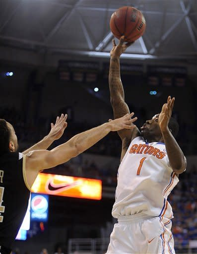 Florida's Kenny Boynton (1) shoots over Vanderbilt's Jeffrey Taylor (44) defends during the first half of an NCAA college basketball game in Gainesville, Fla., Saturday, Feb. 4, 2012. (AP Photo/Phil Sandlin)