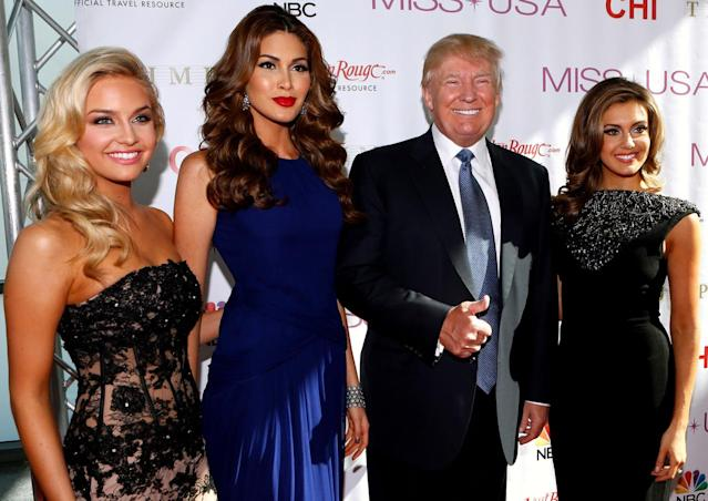 <p>From left, Miss Teen USA 2013 Cassidy Wolf, Miss Universe 2013 Gabriela Isler, Trump, and Miss USA 2013 Erin Brady pose during a red carpet event before the Miss USA 2014 pageant in Baton Rouge, La., on June 8, 2014. <i>(Photo: Jonathan Bachman/AP)</i> </p>