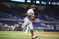 Washington Nationals left fielder Kyle Schwarber (12) rounds first base after hitting a solo home run during the first inning of a baseball game on Thursday, June 24, 2021, in Miami. (AP Photo/Mary Holt)