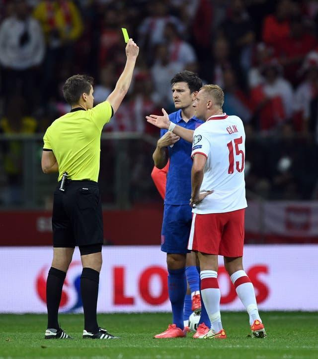 England's Harry Maguire and Poland's Kamil Glik were booked for unsporting behaviour