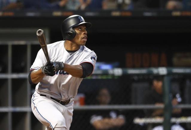 Miami Marlins' Curtis Granderson watches his two-run home run off Chicago White Sox starting pitcher Dylan Covey during the fourth inning of a baseball game Tuesday, July 23, 2019, in Chicago. Starlin Castro also scored. (AP Photo/Charles Rex Arbogast)