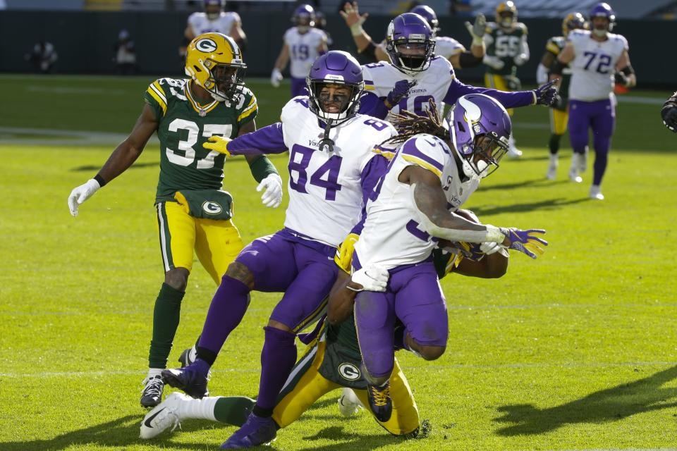 Minnesota Vikings' Dalvin Cook breaks away for a touchdown during the second half of an NFL football game against the Green Bay Packers Sunday, Nov. 1, 2020, in Green Bay, Wis. (AP Photo/Mike Roemer)