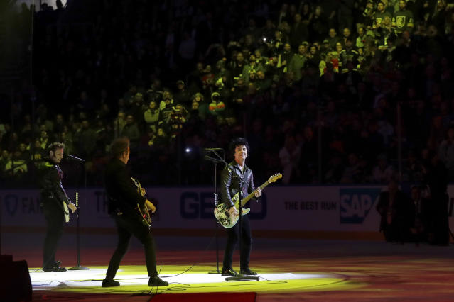 The group Green Day performs between NHL hockey All Star games Saturday, Jan. 25, 2020, in St. Louis. (AP Photo/Jeff Roberson)