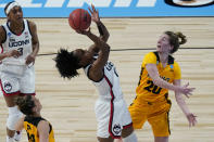 UConn guard Christyn Williams (13) shoots over Iowa guard Kate Martin (20) during the first half of a college basketball game in the Sweet Sixteen round of the women's NCAA tournament at the Alamodome in San Antonio, Saturday, March 27, 2021. (AP Photo/Eric Gay)