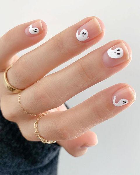 """<p>If extravagant nails aren't really your thing, ask for something simple, but cute like these little ghosts.</p><p><a href=""""https://www.instagram.com/p/BpCoY3GgmsG/"""" rel=""""nofollow noopener"""" target=""""_blank"""" data-ylk=""""slk:See the original post on Instagram"""" class=""""link rapid-noclick-resp"""">See the original post on Instagram</a></p>"""