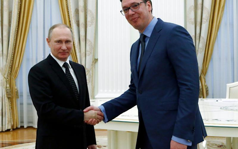 Vladimir Putin, left, shakes hands with Aleksandar Vucic in the Kremlin on March 27 - Credit:  SERGEI KARPUKHIN / POOL/ REUTERS POOL