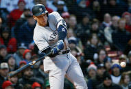 New York Yankees' Aaron Judge hits a single during the first inning of the team's baseball game against the Boston Red Sox in Boston, Tuesday, April 10, 2018. (AP Photo/Michael Dwyer)