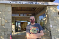 """Erik Peterson, 52, stands outside the Veterans Memorial Building after voting to recall California Gov. Gavin Newsom in Lafayette, Calif., on Tuesday, Sept. 14, 2021. Peterson, who works in construction, is a registered Democrat who says he tends to vote Republican. He voted for Larry Elder because he felt """"Newsom's handling of the pandemic was terrible. He told us to shelter in place and stay home and he's out doing fundraisers, unmasked,"""" he said referring to Newsom's now infamous meal at the French Laundry. (AP Photo/Jocelyn Gecker)"""