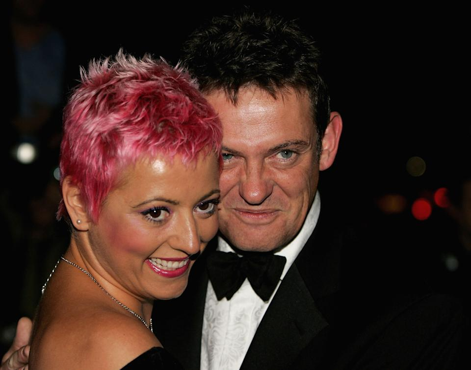LONDON - OCTOBER 05: TV presenter Matthew Wright and Caroline Monk arrive at the Breast Cancer Care 2005 Fashion Show at Grosvenor House, Park Lane on October 5, 2005 in London, England. The annual fashion show aims to raise awareness of breast cancer and forms part of Breast Cancer Awareness Month, October 1-31. (Photo by Chris Jackson/Getty Images)