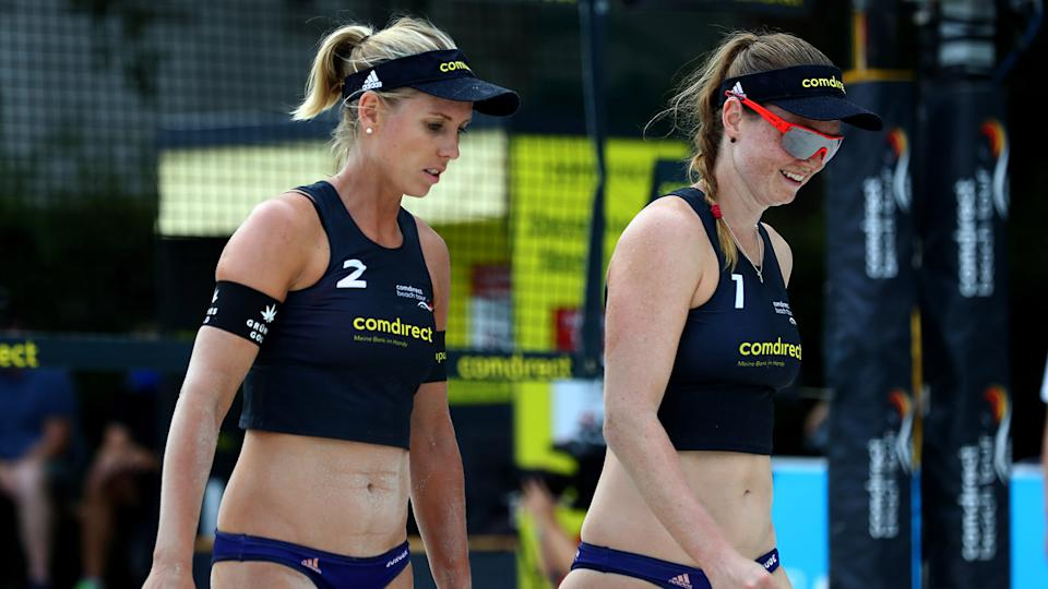 HAMBURG, GERMANY - AUGUST 16: Karla Borger (R) of Germany talks to team mate Julia Sude of Germany on day three of the comdirect Beach Tour 2020 on August 16, 2020 in Hamburg, Germany. (Photo by Martin Rose/Bongarts/Getty Images)