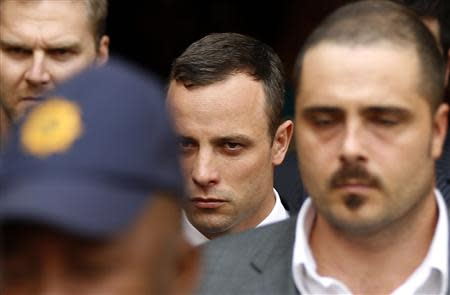 South African Olympic and Paralympic track star Oscar Pistorius leaves after his trial at the high court in Pretoria