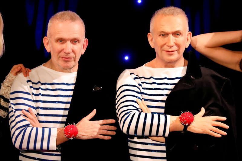 FILE PHOTO: French fashion designer Jean-Paul Gaultier stands next to his figure made by French sculptor Eric Saint Chaffray at the Grevin wax museum during the presentation of his waxwork in Paris
