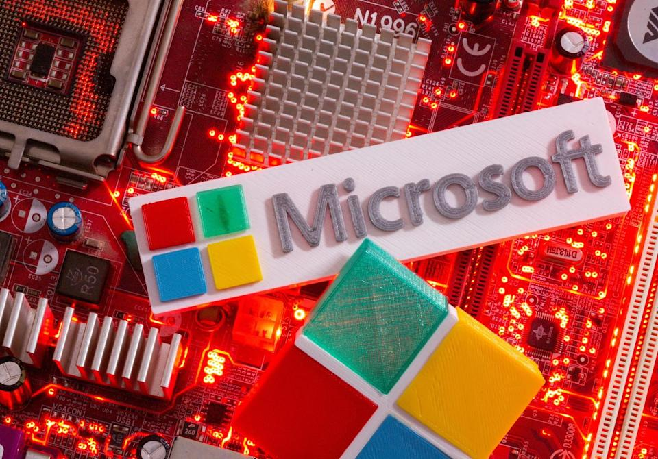 3D-printed Microsoft logos are seen on a computer motherboard in this picture illustration taken July 22, 2021. REUTERS/Dado Ruvic/Illustration - RC2BPO9KW4R4