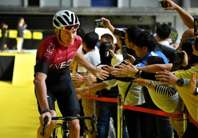 Chris Froome rode a short 3.2km team time-trial the Saitama criterium Sunday, his first official race since a horror crash in June (AFP Photo/Kazuhiro NOGI)