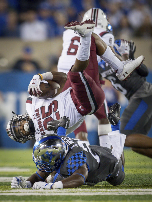 Kentucky safety Darius West (25) tackles South Carolina running back A.J. Turner (25) during the second half of an NCAA college football game in Lexington, Ky., Saturday, Sept. 29, 2018. (AP Photo/Bryan Woolston)