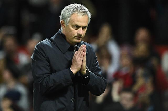 Manchester United's Portuguese manager Jose Mourinho gestures to supporters after their match against Manchester City on October 26, 2016 (AFP Photo/Oli Scarff)
