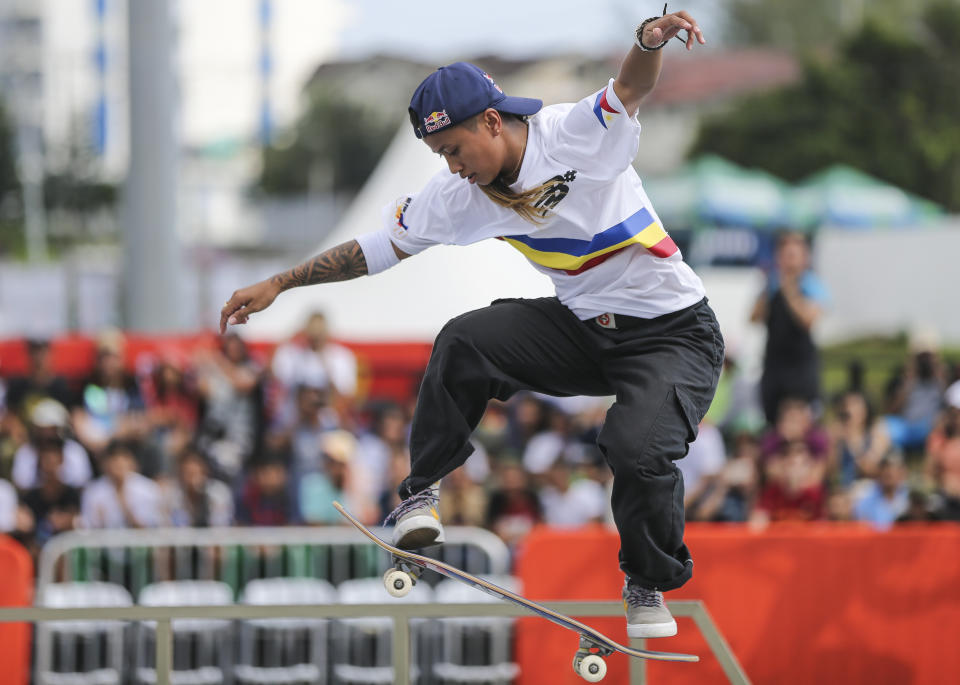 Philippines' Margielyn Didal jumps during the street event finals of skateboarding at the 30th South East Asian Games in Tagaytay City, Cavite Province, Philippines, on Saturday, December 7, 2019. (AP Photo/Jijo de Guzman)