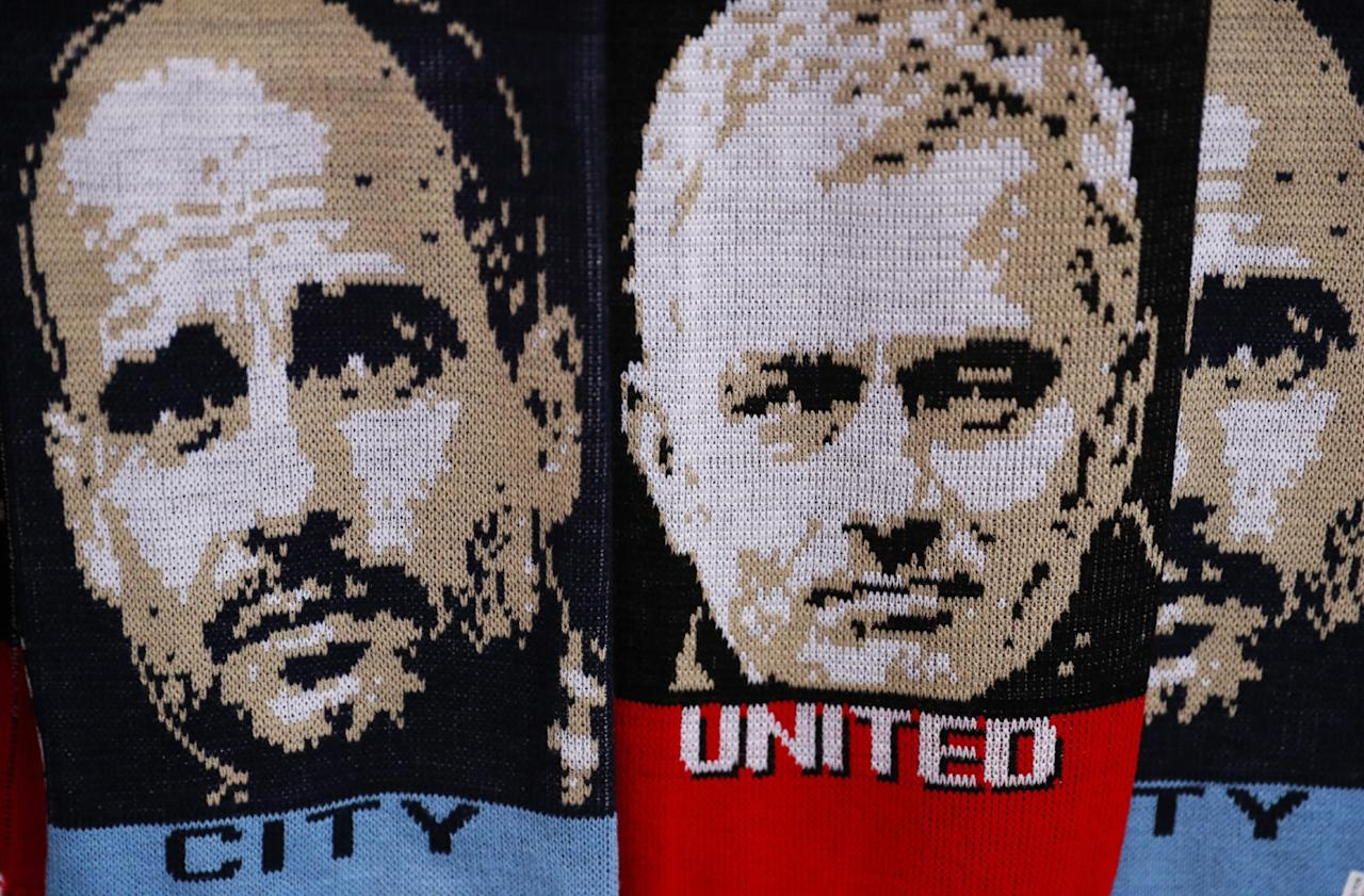 """Football Soccer Britain - Manchester United v Manchester City - EFL Cup Fourth Round - Old Trafford - 26/10/16 Scarves with the faces of Manchester City manager Pep Guardiola and Manchester United manager Jose Mourinho are sold outside the stadium before the match  Action Images via Reuters / Jason Cairnduff Livepic EDITORIAL USE ONLY. No use with unauthorized audio, video, data, fixture lists, club/league logos or """"live"""" services. Online in-match use limited to 45 images, no video emulation. No use in betting, games or single club/league/player publications. Please contact your account representative for further details."""