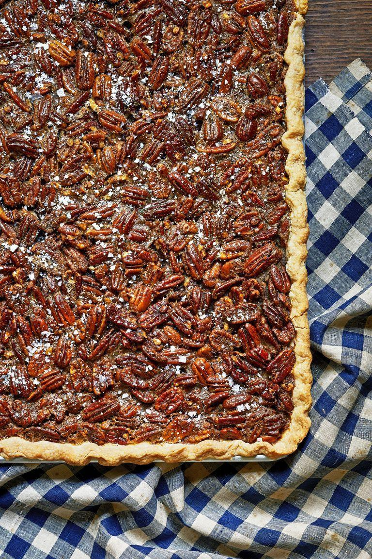 "<p>Why make two pecan pies when you can just make this easy pecan slab pie that'll feed 16 people?</p><p><strong><a href=""http://www.countryliving.com/food-drinks/a29145983/nancy-fuller-pecan-slab-pie/"" rel=""nofollow noopener"" target=""_blank"" data-ylk=""slk:Get the recipe"" class=""link rapid-noclick-resp"">Get the recipe</a>.</strong></p><p><a class=""link rapid-noclick-resp"" href=""https://www.amazon.com/USA-Pan-Bakeware-Resistant-Aluminized/dp/B0029JQE3M/ref=sr_1_1_sspa?tag=syn-yahoo-20&ascsubtag=%5Bartid%7C10050.g.635%5Bsrc%7Cyahoo-us"" rel=""nofollow noopener"" target=""_blank"" data-ylk=""slk:SHOP JELLY ROLL PANS"">SHOP JELLY ROLL PANS</a></p>"
