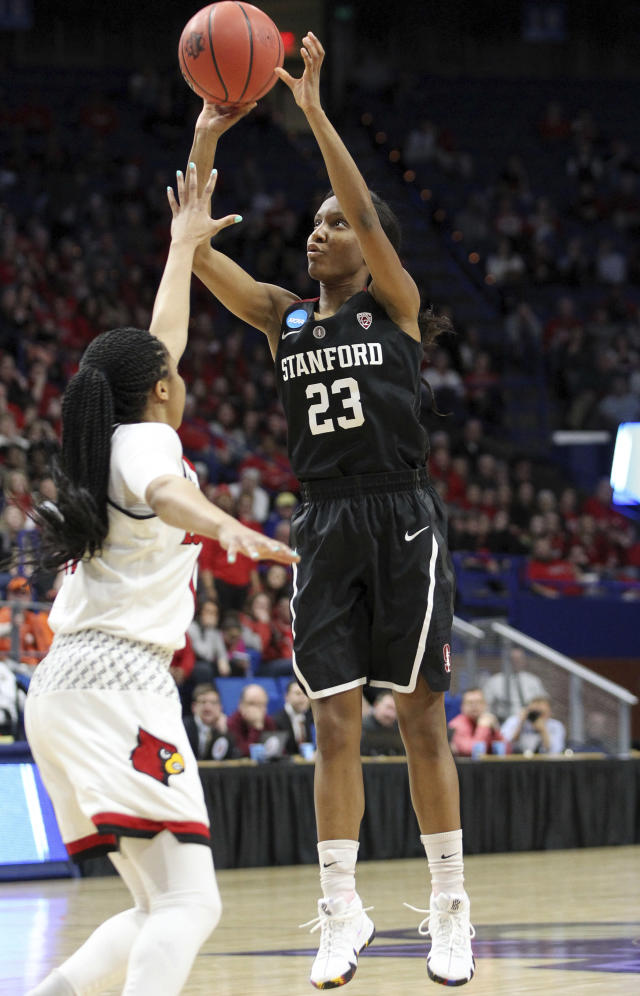 Stanford's Kiana Williams (23) shoots while defended by Louisville's Arica Carter during the second half of an NCAA women's college basketball tournament regional semifinal Friday, March 23, 2018, in Lexington, Ky. (AP Photo/James Crisp)