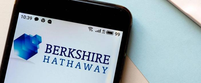 Berkshire Hathaway logo is seen displayed on a smartphone