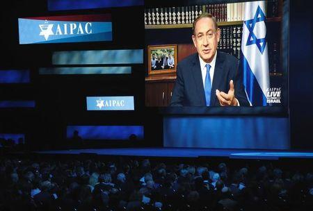 Israeli Prime Minister Benjamin Netanyahu speaks via a video link from Israel to the American Israel Public Affairs Committee (AIPAC) policy conference in Washington
