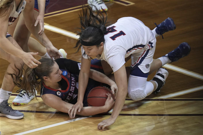 Gonzaga's Kaylynne Truong (14) battles Belmont's Jamilyn Kinney, bottom, for a loose ball during the first half of a college basketball game in the first round of the women's NCAA tournament at the University Events Center in San Marcos, Texas, Monday, March 22, 2021. (AP Photo/Chuck Burton)