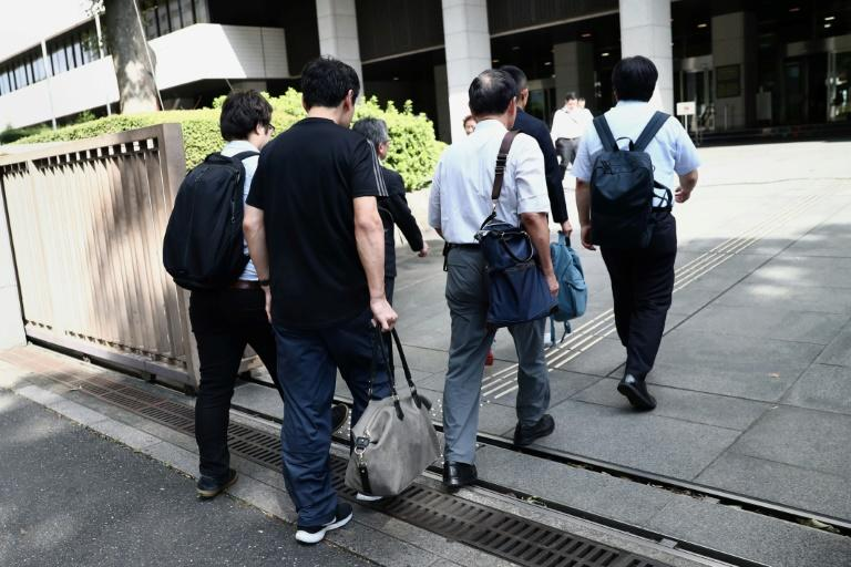 A Japanese man has taken his employer to court, saying that he was penalised for taking paternity leave
