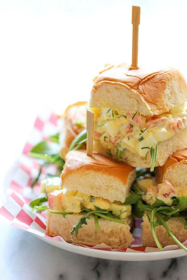 """<p>The duo of silky egg salad and soft rolls is so tasty, you'll have trouble not sneaking some from your kid.</p> <p><strong>Get the recipe:</strong> <a href=""""https://damndelicious.net/2014/01/29/skinny-egg-salad-sliders/"""" target=""""_blank"""" class=""""ga-track"""" data-ga-category=""""Related"""" data-ga-label=""""https://damndelicious.net/2014/01/29/skinny-egg-salad-sliders/"""" data-ga-action=""""In-Line Links"""">egg salad sliders</a></p>"""