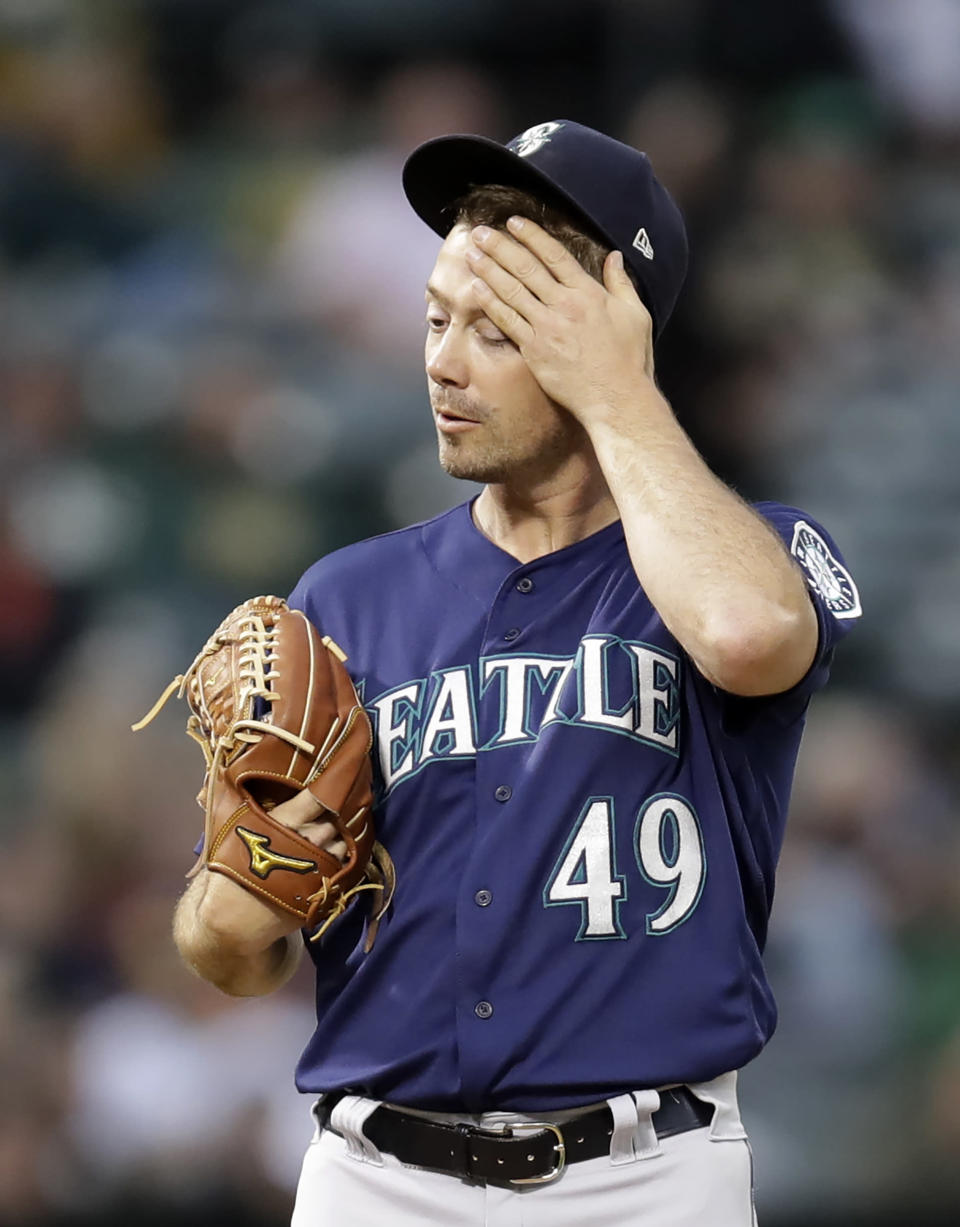 Seattle Mariners' Wade LeBlanc wipes his face in the fourth inning of a baseball game against the Oakland Athletics, Saturday, June 15, 2019, in Oakland, Calif. (AP Photo/Ben Margot)