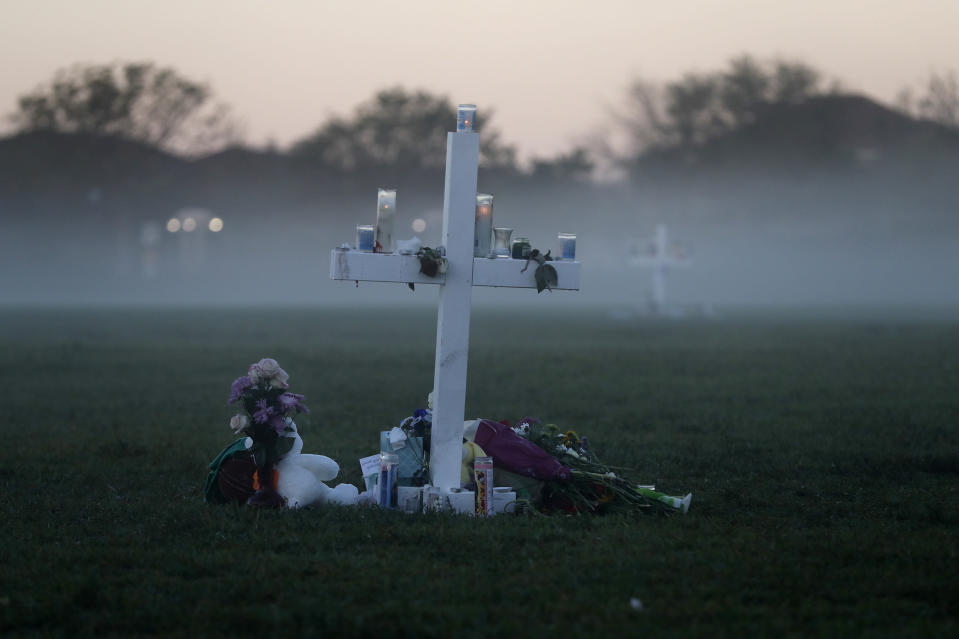 FILE - In this Feb. 17, 2018, file photo, an early morning fog rises where 17 memorial crosses were placed for the 17 students and faculty killed in the shooting at Marjory Stoneman Douglas High School in Parkland, Fla. It's been more than 1,000 days since a gunman with an AR-15 rifle burst in and opened fire. And yet, with Valentine's Day on Sunday, Feb. 14, 2021, marking the three-year milestone, the death penalty trial of Nikolas Cruz is in limbo. (AP Photo/Gerald Herbert, File)