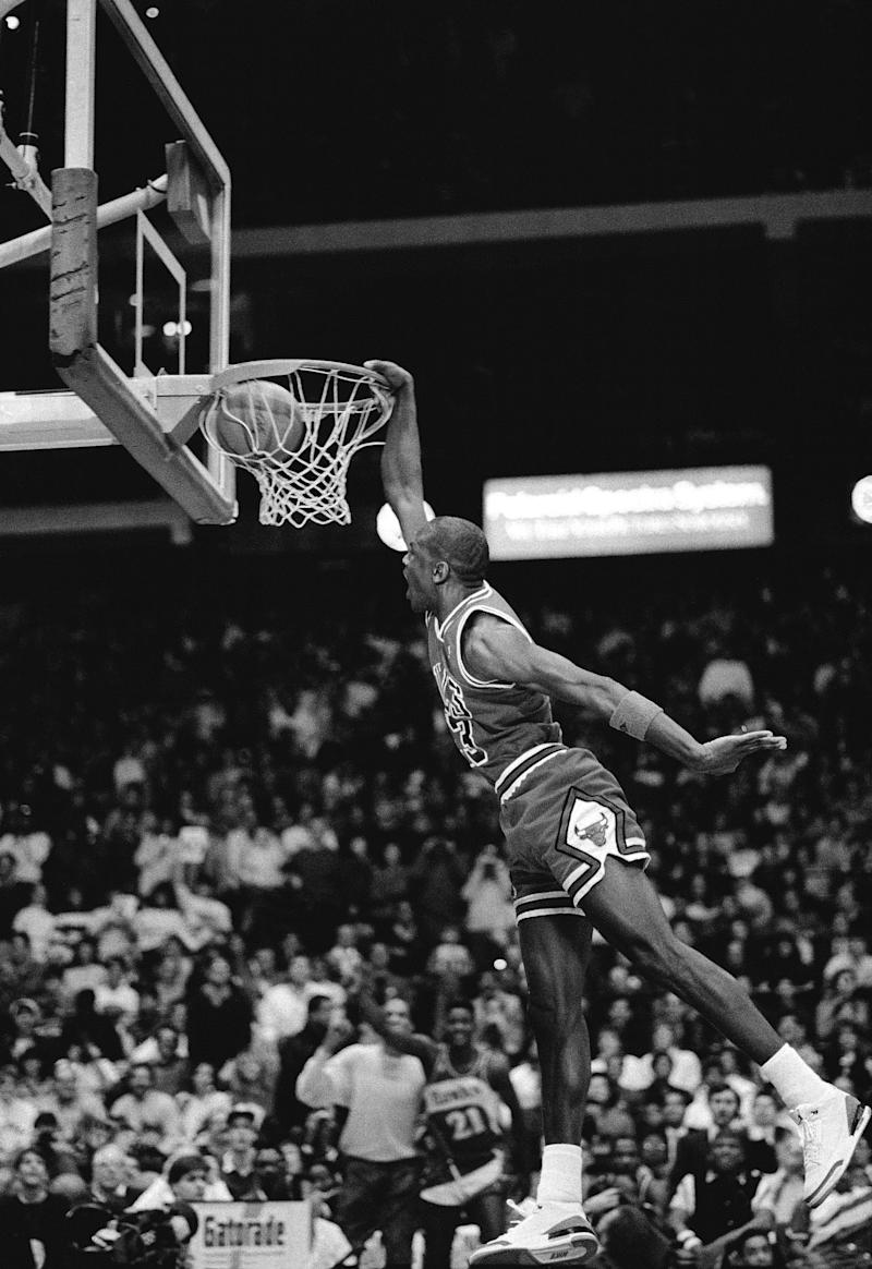 CHICAGO, IL - FEBRUARY 6: Michael Jordan #23 of the Chicago Bulls attempts a dunk during the 1988 Slam Dunk Contest on February 6, 1988 at Chicago Stadium in Chicago, Illinois. NOTE TO USER: User expressly acknowledges and agrees that, by downloading and or using this photograph, User is consenting to the terms and conditions of the Getty Images License Agreement. Mandatory Copyright Notice: Copyright 1988 NBAE (Photo by Nathaniel S. Butler/NBAE via Getty Images)
