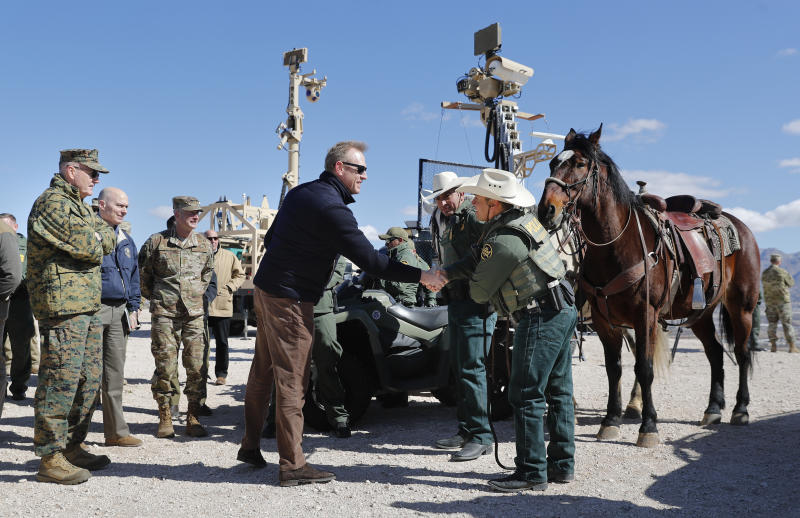 Acting Secretary of Defense Patrick Shanahan, center, greets Border Patrol Agents Carlos Lerma, second from the right, Moises Gonzalez, right, and the horse they use for patrols during a tour of the US-Mexico border at Santa Teresa Station in Sunland Park, N.M., Saturday, Feb. 23, 2019. On the far left is Joint Chiefs Chairman Gen. Joseph Dunford. Top defense officials toured sections of the U.S.-Mexico border Saturday to see how the military could reinforce efforts to block drug smuggling and other illegal activity, as the Pentagon weighs diverting billions of dollars for President Donald Trump's border wall. (AP Photo/Pablo Martinez Monsivais)
