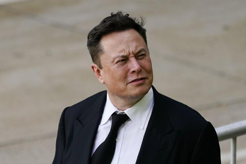 Elon Musk walks from the the justice center in Wilmington, Del., Monday, July 12, 2021. Musk took to a witness stand Monday to defend his company's 2016 acquisition of a troubled company called SolarCity against a shareholder lawsuit that claims he's to blame for a deal that was rife with conflicts of interest and never delivered the profits he had promised. (AP Photo/Matt Rourke)