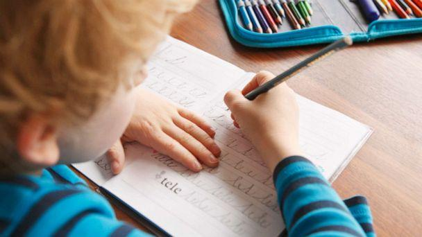 PHOTO: A boy appears to learn to write in cursive in this stock photo. (STOCK PHOTO/Getty Images)