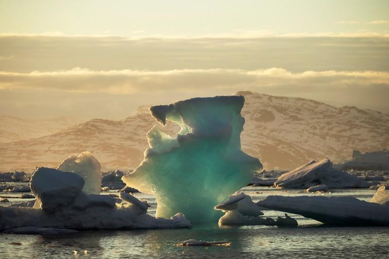 FILE PHOTO: An iceberg floats in a fjord near Tasiilaq, Greenland
