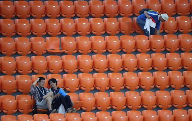 Soccer Football - World Cup - Group H - Japan vs Senegal - Ekaterinburg Arena, Yekaterinburg, Russia - June 24, 2018 Japan fans clean up after themselves after the match REUTERS/Marcos Brindicci