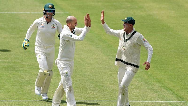 Nathan Lyon (C) has made two breakthroughs on day four of the 2nd Test against Pakistan in Adelaide